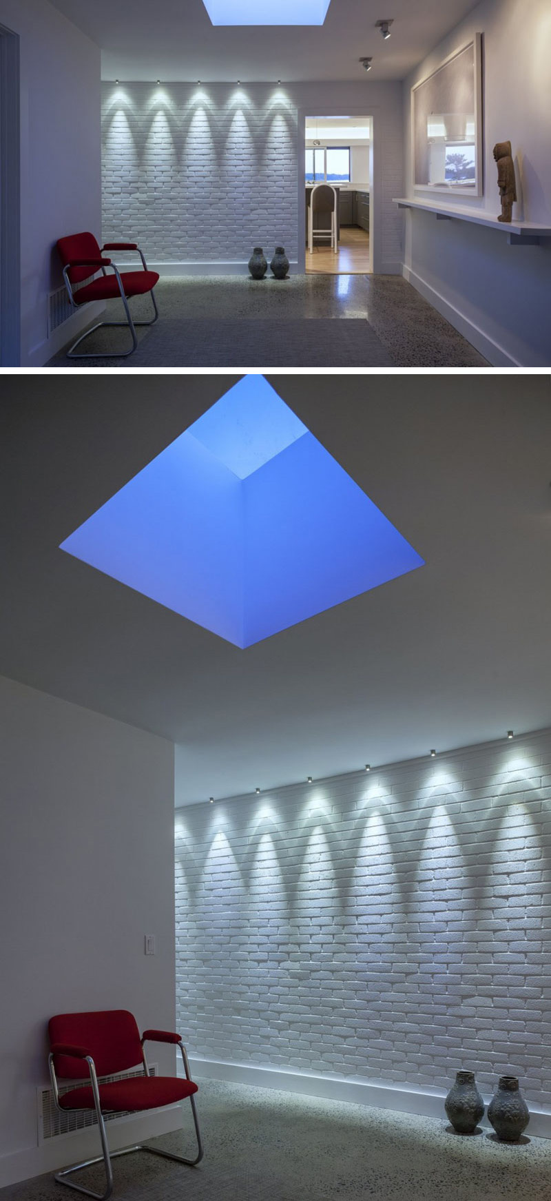 The front entrance of this modern house is bright and welcoming with the use of down lighting on a white brick wall, and a skylight. Selected art pieces are displayed by spot lighting, and a white shelf.