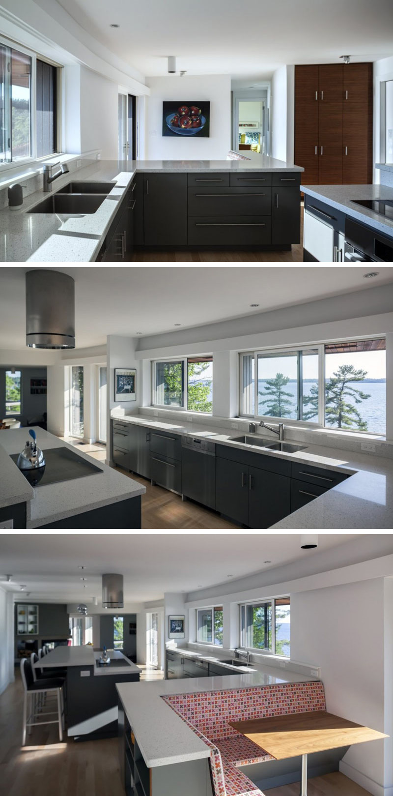In this modern kitchen, grey cabinetry and stone countertops provide plenty of storage and work space. Built-in at the end of the kitchen counter is seating with a retro upholstered pattern, and a small wood table has been added to provide more options for dining.