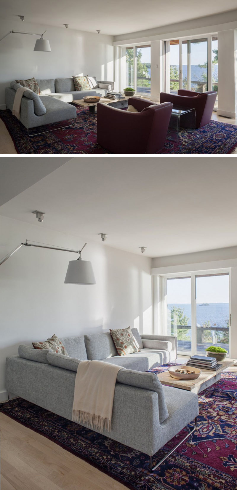 In this modern living room, a grey upholstered L-shape couch, and two red sofa chairs sit beside sliding glass doors that lead to the balcony. A large red Persian rug is placed on the wood floor to make the room a comfortable place to relax.