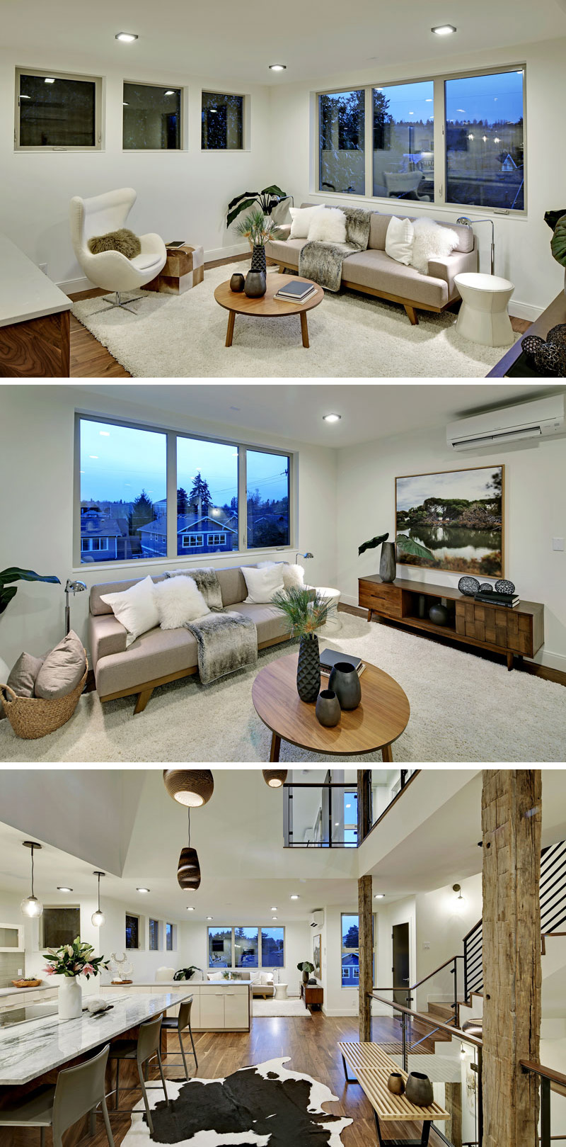 Going through the main floor of this modern home, the living room is decorated in whites and soft greys. A large white area rug has been placed on the solid walnut wood floor, which is used throughout the home.