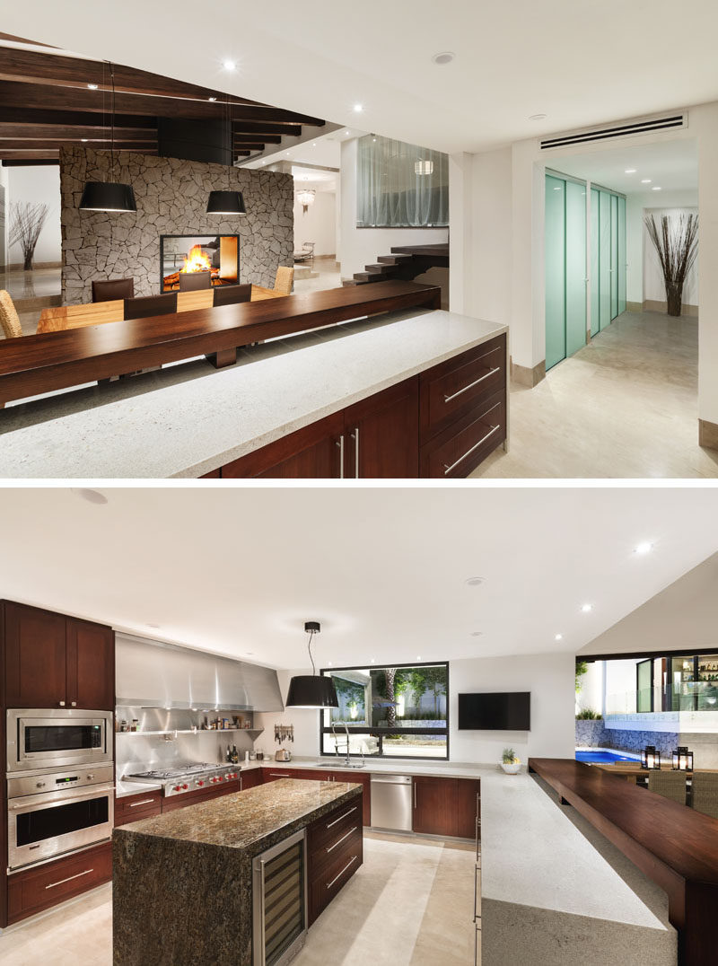 In this modern renovated kitchen, the ceiling height is lower than that of the dining room, so upper cabinets were not installed to provide the space with a feeling of openness. A custom-made stove exhaust was designed to add a touch of industrial and to help reflect the light all over the kitchen, while itauna granite was installed for the countertops to provide durability.