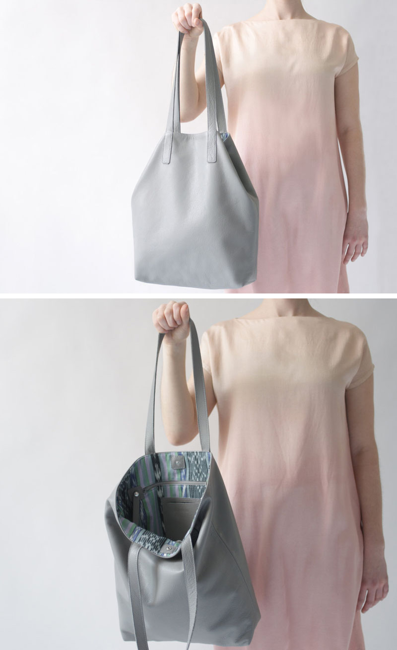 This modern large grey leather bag has a pattern lining and is easy to use.