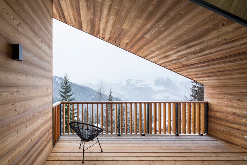 The covered balcony of this mountain house is the perfect place to enjoy the views.