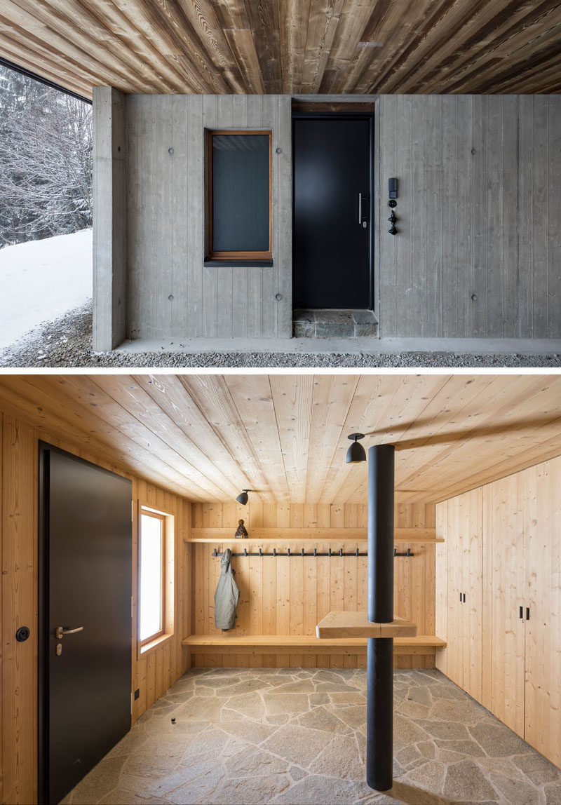 This modern mountain house has been designed so that the garage is open to the elements, yet still covered enough to provide protection in the cooler months. Upon entering the home, there's a room where you can hang up your wet jackets and muddy boots.