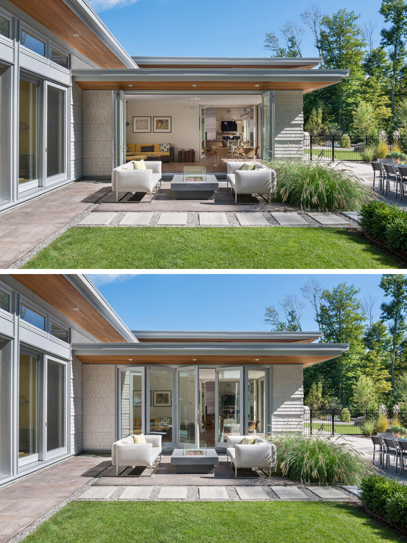 Off to the side of the main living area in this modern house is a second, more casual living room and small dining area. This casual area has folding glass doors that opens up to an outdoor lounge with fire table.