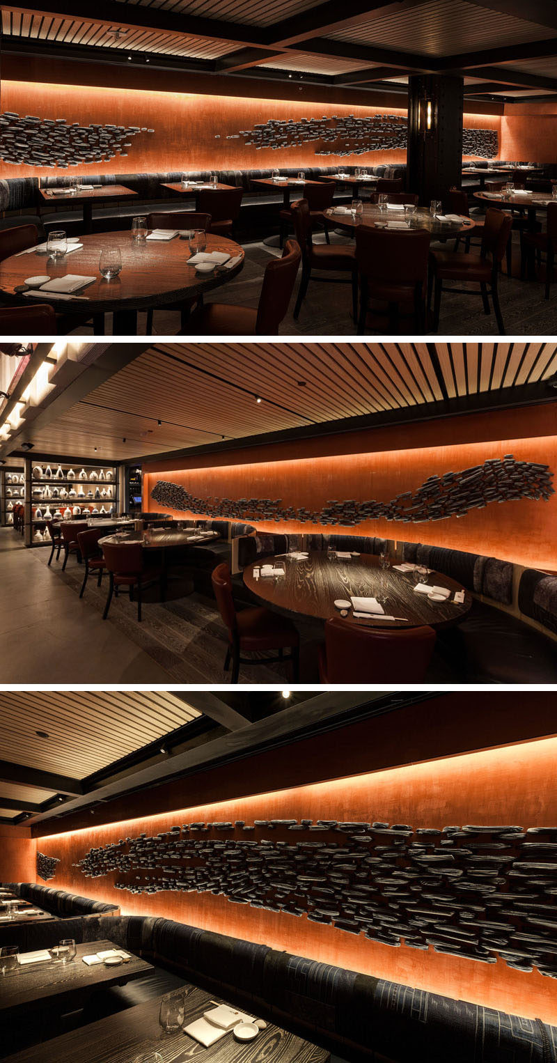 Nobu Downtown (NYC) has a large ceramic art installation along its walls. The installation is made up of 3,500 ceramic pieces that resemble briquettes of charred wood, organized to look like the positive and negative space from the stroke of a large brush.