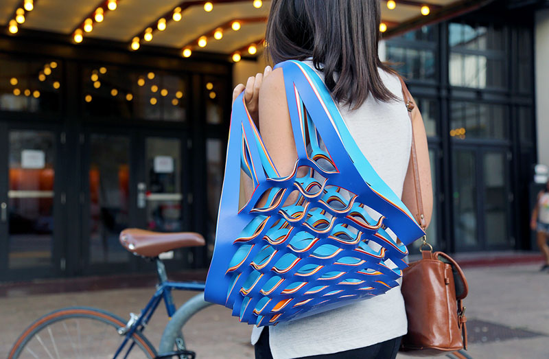 This modern blue reusable plastic bag is easy to carry, and expands to fit various contents.