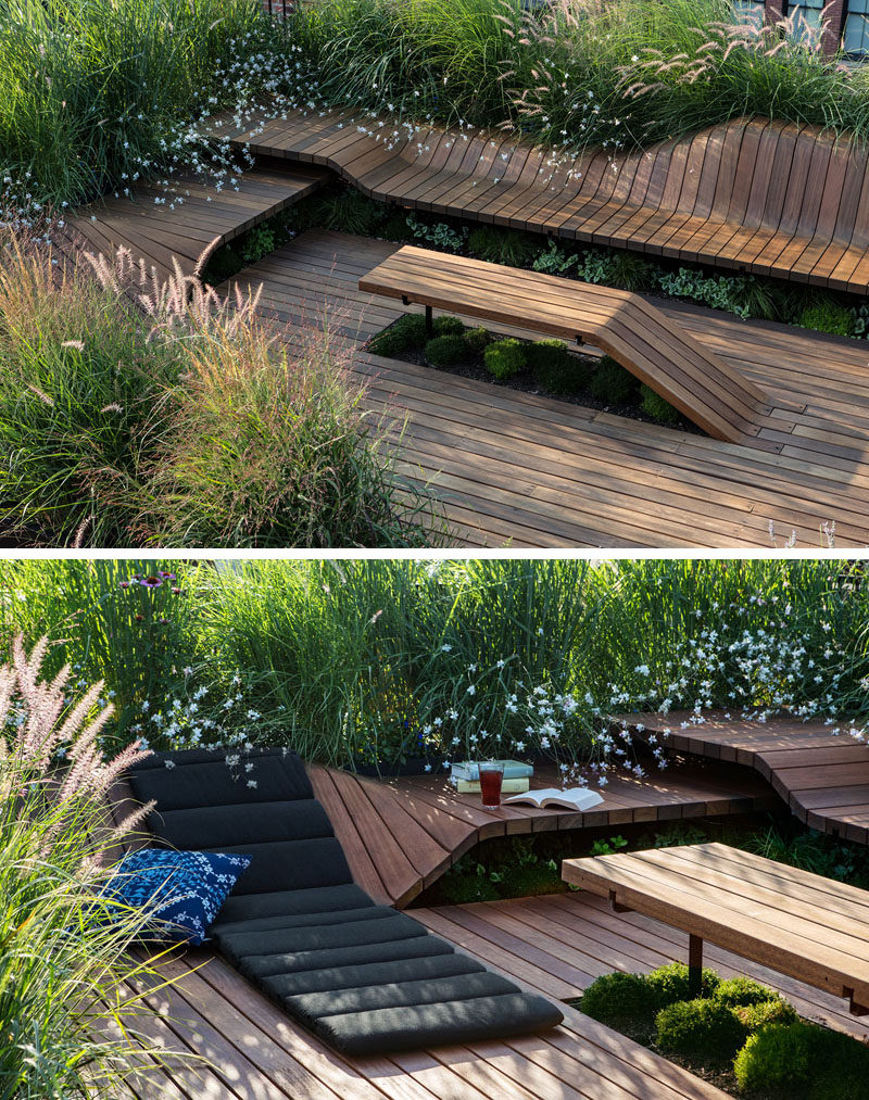 This rooftop deck has custom designed wood benches for Rooftop landscape design