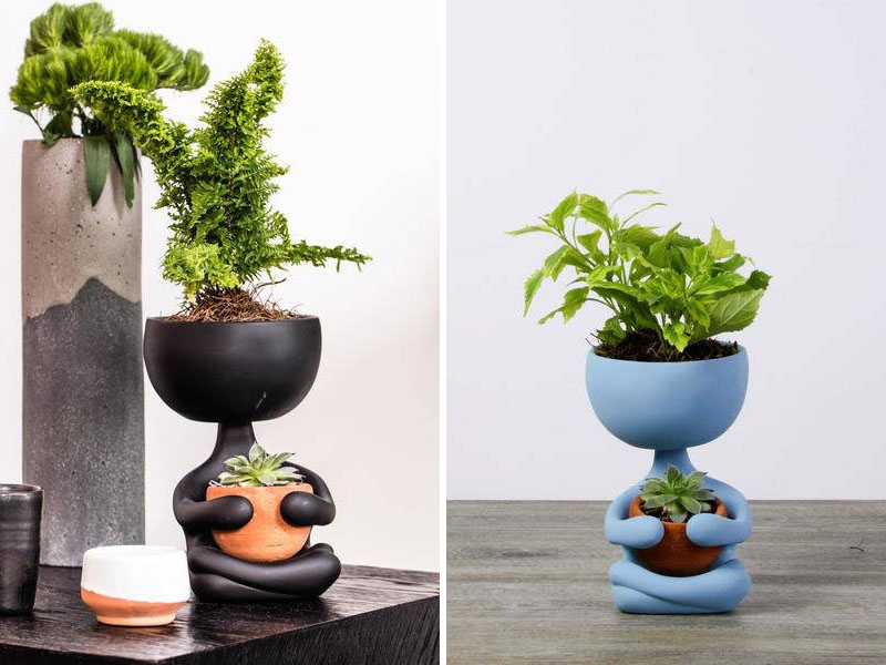 These modern black and blue ceramic planters are crossed legged and zen like, holding their potted plants close.
