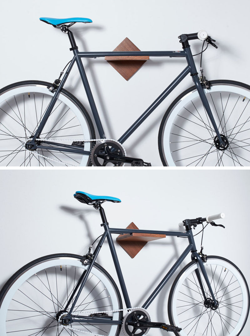 Made from warm mahogany wood, this modern bike rack is ideal for hanging your bike in a small space.