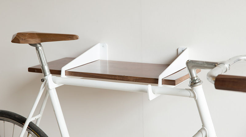 This white and wood modern shelf provides storage and a place for you to hang your bike at the end of the day.
