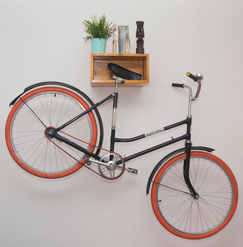 Making sure your home decor doesn't take a hit, this light wood modern bike rack doubles as a shelf for ornamental displays, and a convenient place to store your bike.