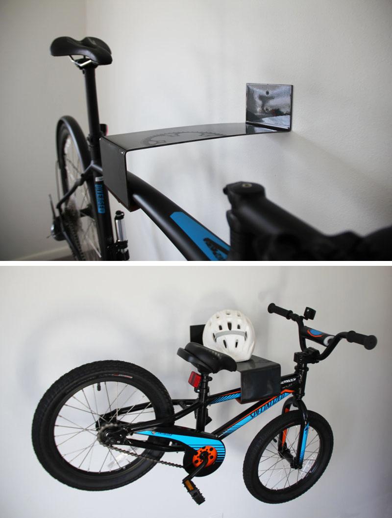A modern black steel wall mounted bike rack.