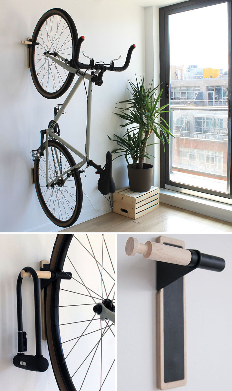 Sturdy and delicate in design, this modern black and wood wall mounted rack provides space for your bike and for your lock.