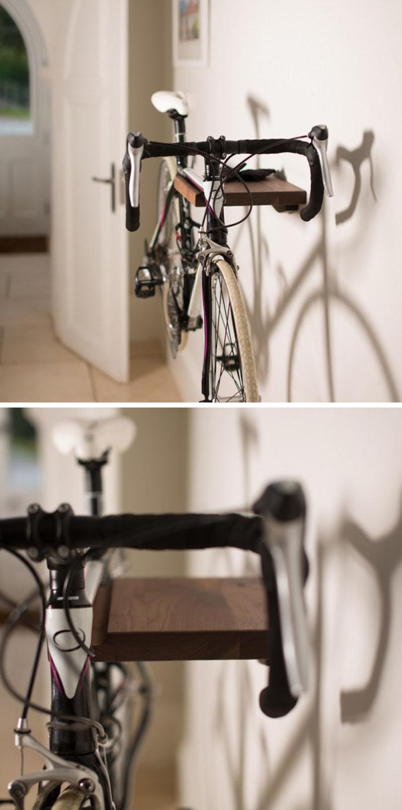 A simple wall mounted wood bike rack.