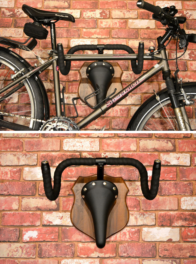 Made from recycled bike parts, this modern creative rack is meant to mimic hunting trophies. However, it's very clear that this handlebar, wood mounted rack is meant for bicycles.
