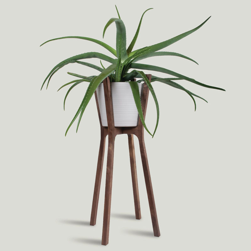 Made for indoor use only, this handmade modern walnut wood plant stand is perfectly designed for holding your plants that can't be outside.