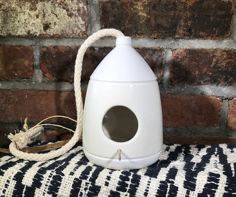 This simple yet modern birdhouse is made from wheel-thrown porcelain.