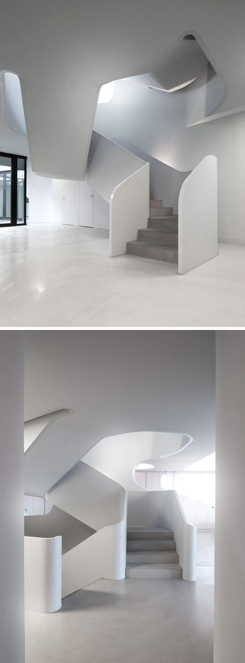 Entering into the home, a sculptural white set of stairs with smooth concrete steps leads you to the second floor of this modern house.