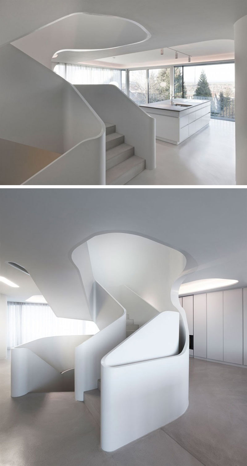 These modern sculptural stairs lead to the third floor of the house.