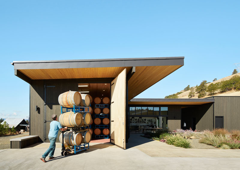 This modern winery courtyard is surrounded by buildings that house the wine barrels, allowing visitors to see and experience the every day workings of the winery.