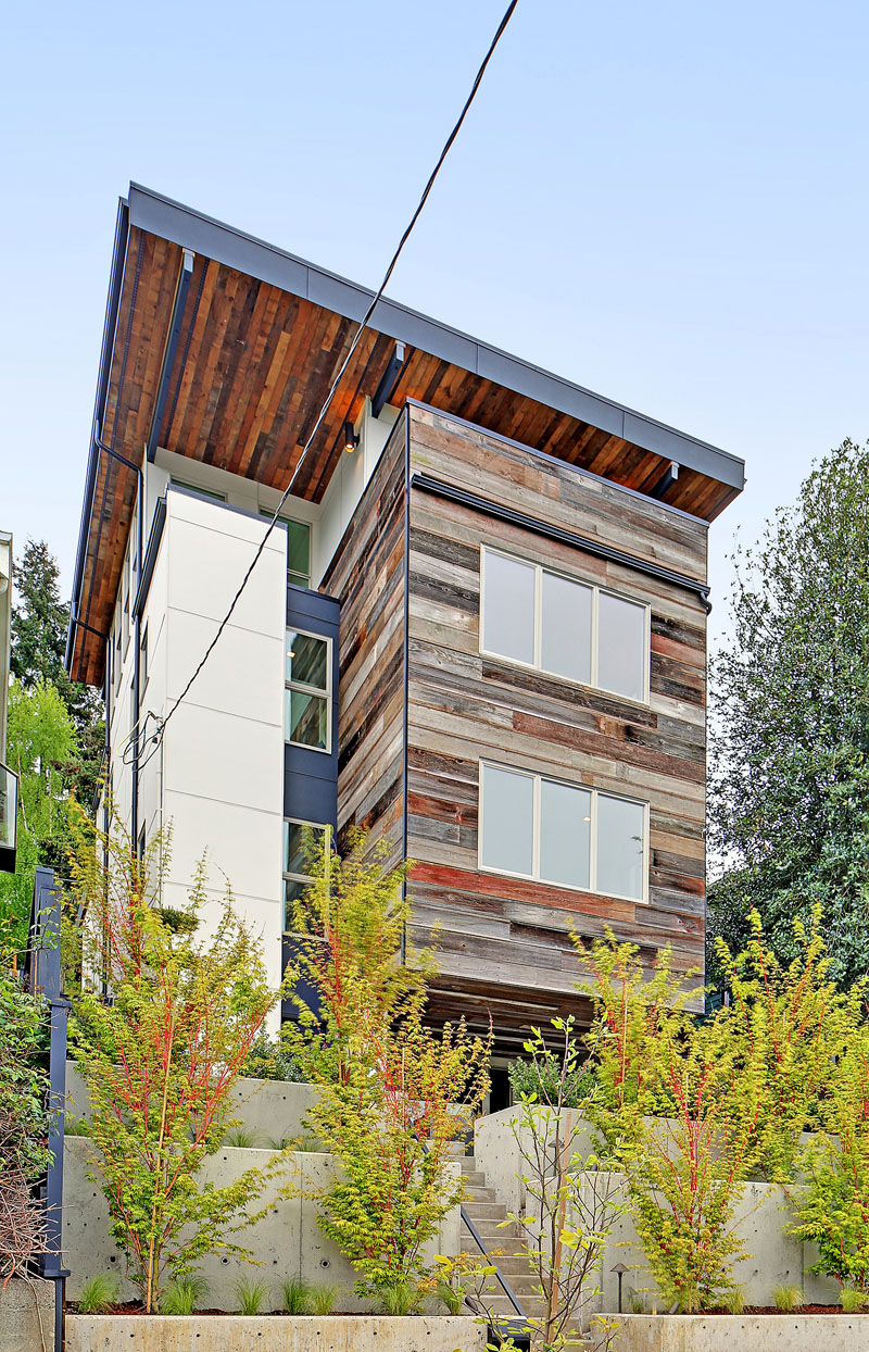The exterior of this modern house is adorned with reclaimed barn wood in various hues, and metals sourced from Oregon.