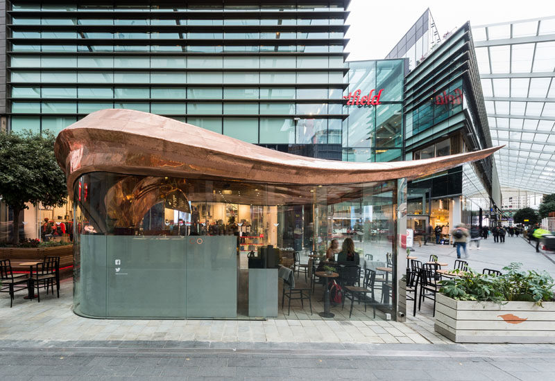 Architecture firm Mizzi Studio have designed Colicci, a new cafe in London, that features a leaf-inspired roof made from 542 individual laser cut copper sections that were attached by hand using traditional techniques and approximately 20,000 rivets.