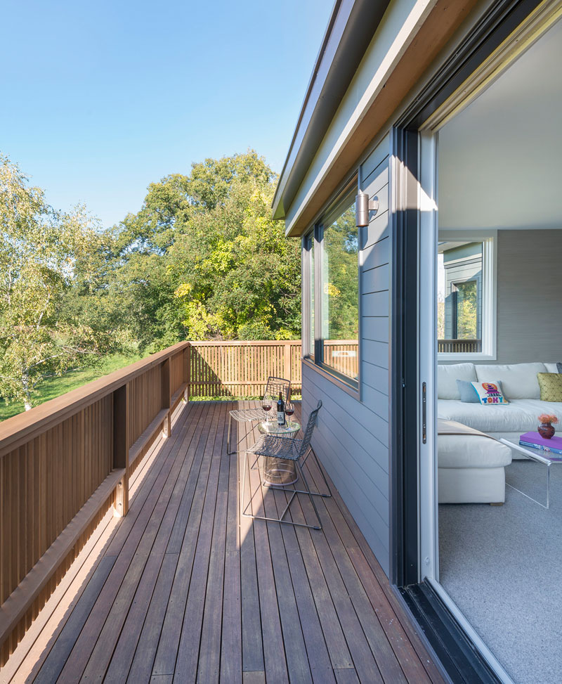 This modern wrap around wood balcony is the perfect place to enjoy a glass of wine and the view.