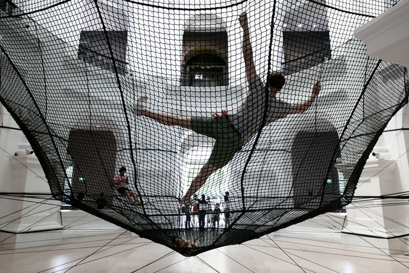 A Suspended Net Is Allowing People To Experience The National Museum Of Singapore From A Different Perspective