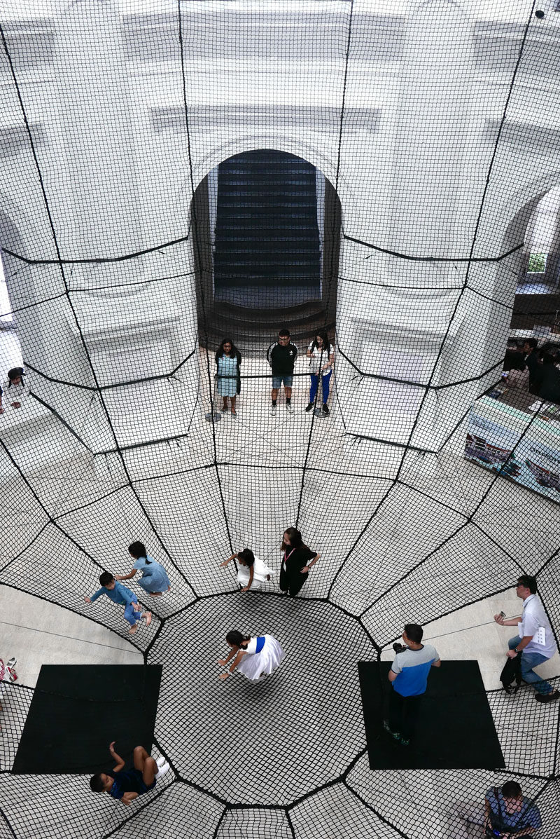 Atelier YokYok have installed a large net within the National Museum of Singapore, that's designed as an inverted dome and allows for visitor interaction.