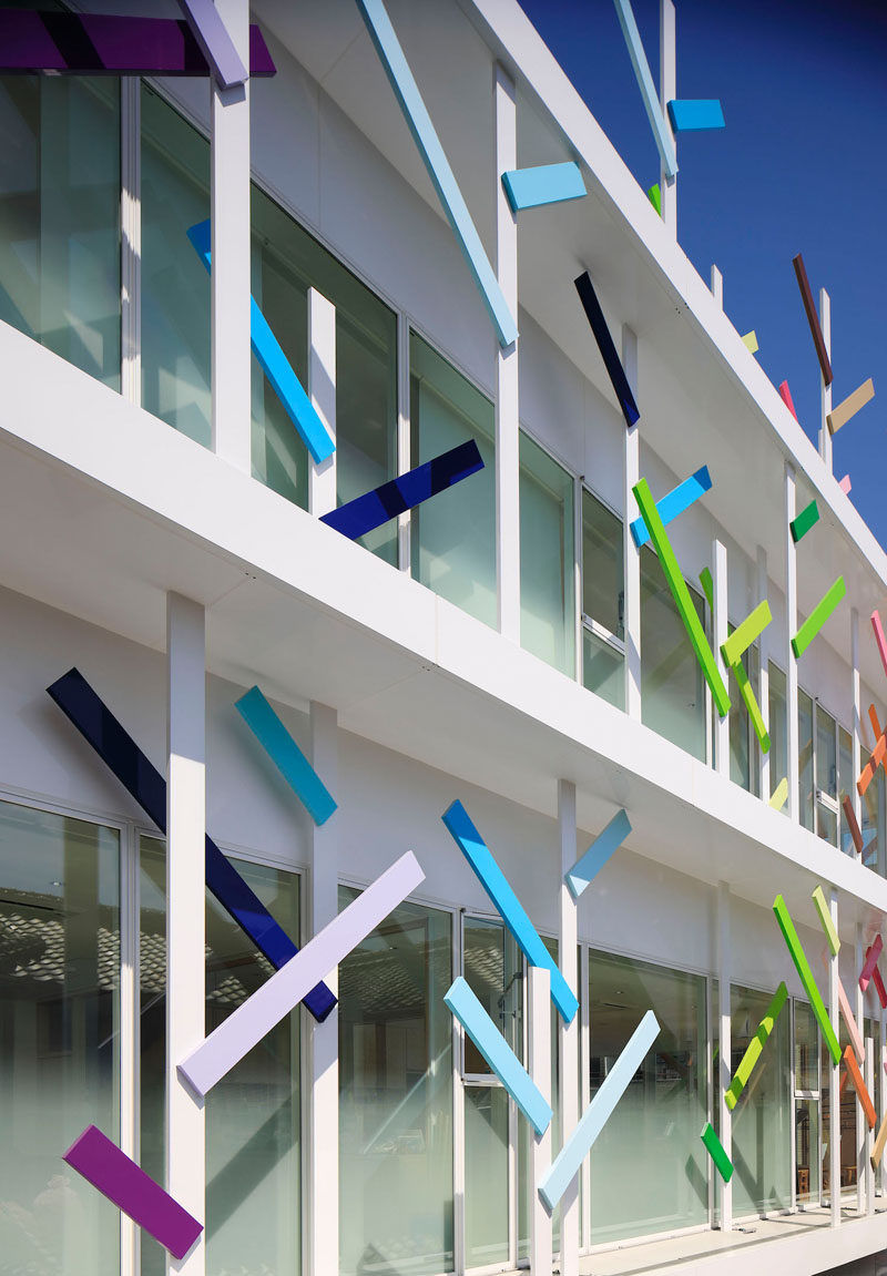 On the facade of this modern kindergarten in Japan are 63 white trees that are 13 ft (4m) high that are covered in colorful branches that wrap the building. 22 colors have been used to create the fun facade.