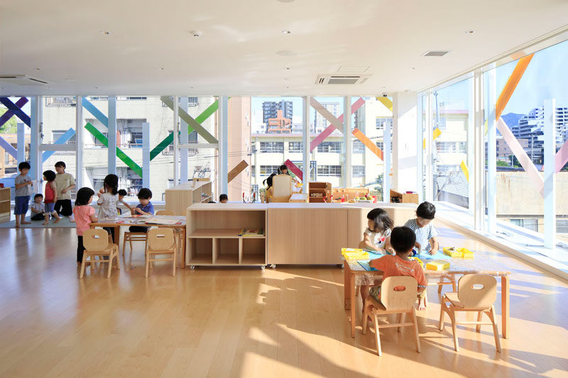 Colorful 'branches' on the exterior of this modern kindergarten can be seen from the interior.