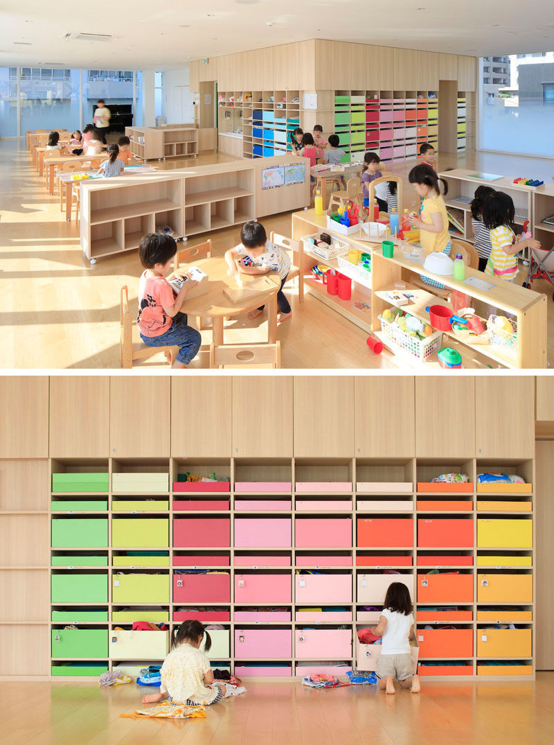 In the main nursery room in this modern kindergarten, 200 colorful boxes in 25 colors are lined up on the wall, allowing each child to know which color belongs to them and where they can keep their personal items.