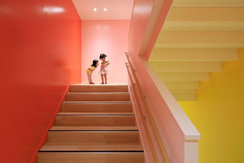 These stairs in a kindergarten are surrounded by colorful walls.