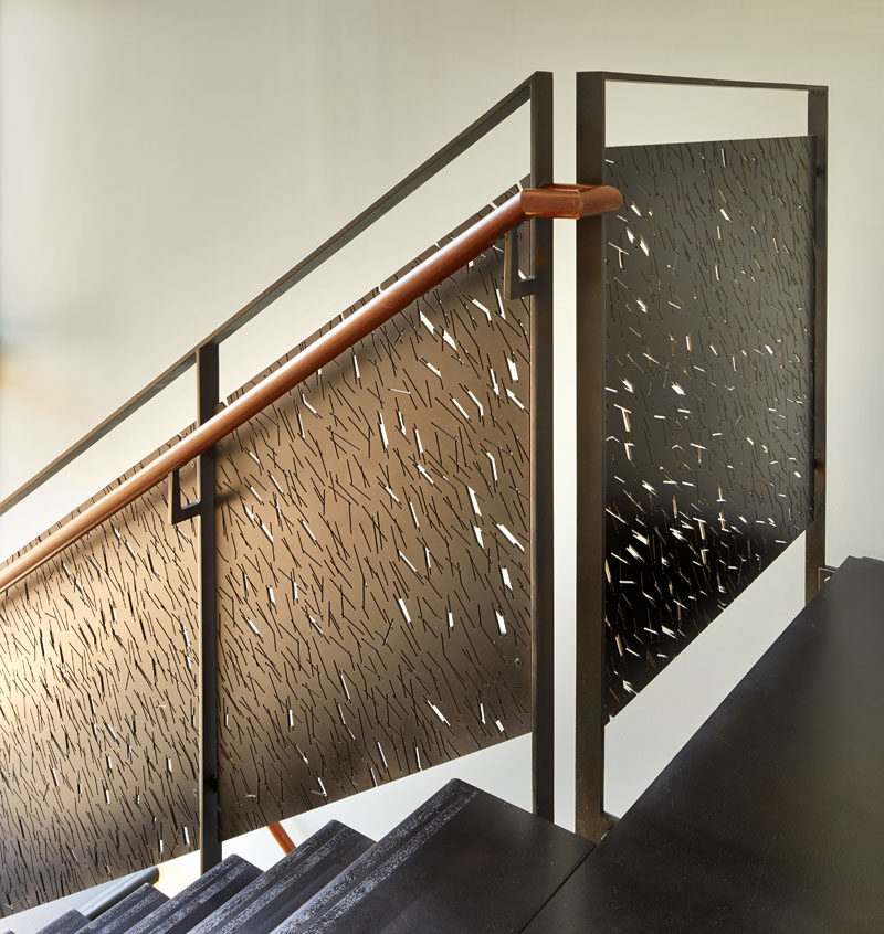 These modern stairs have custom-designed steel railing panels that provide shadow patterns in the stairwell when the sun hits them in the late afternoon.