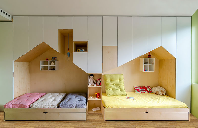 This Fun And Modern Kid S Bedroom Has A Custom Wall Unit That Features Plenty Of Storage
