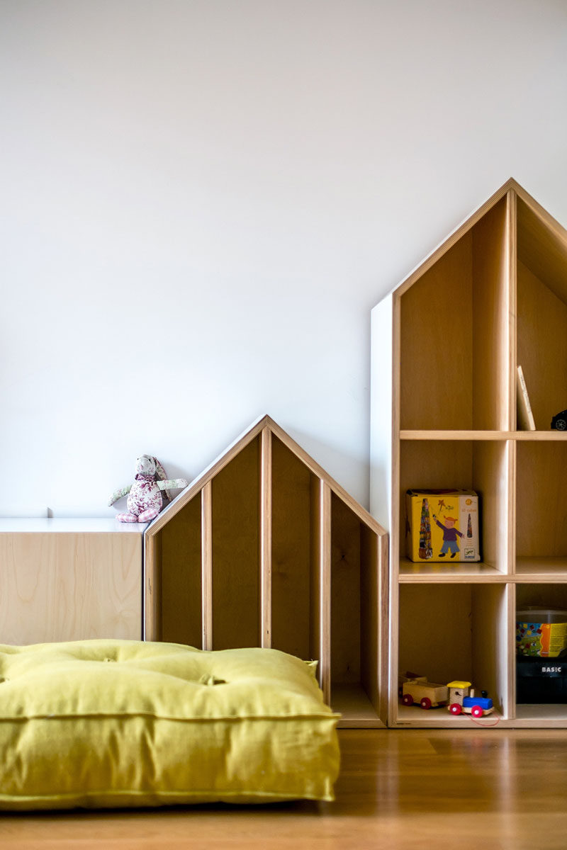 Custom furniture was designed for this fun and modern kid's bedroom.