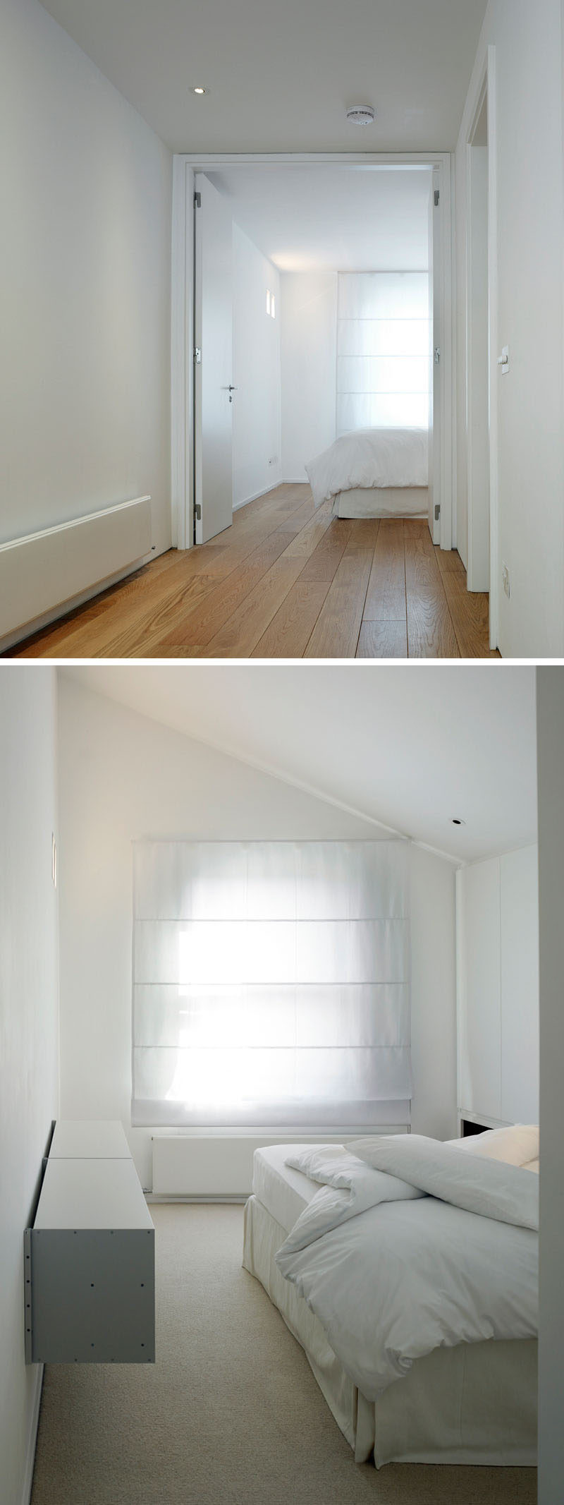 At the top of the stairs in this renovated house, there's a white themed bedroom. A simple window shade creates privacy but also ties in with the overall white appearance of the room.
