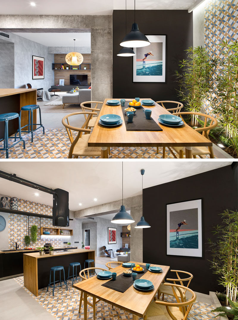 Stepping inside this modern rental apartment, you enter straight into the dining room. Colorful patterned tiles that wrap around from one wall to the other define both the dining room and the kitchen.