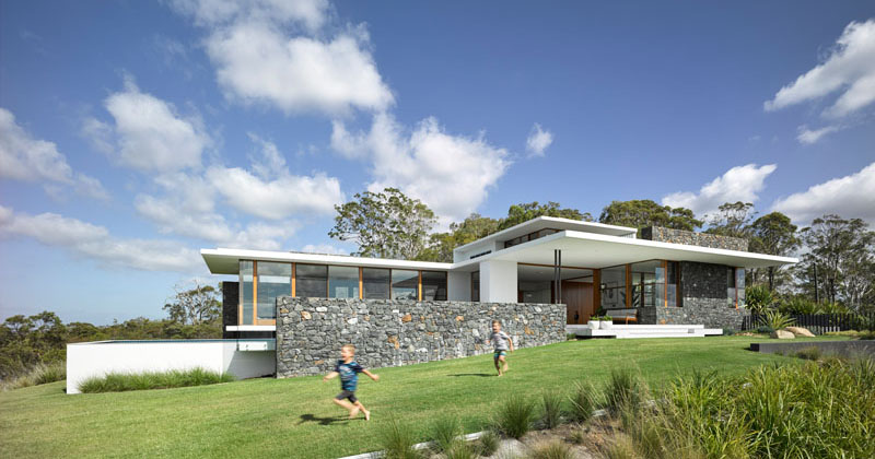 This house with bluestone walls overlooks the landscape for Home architecture australia