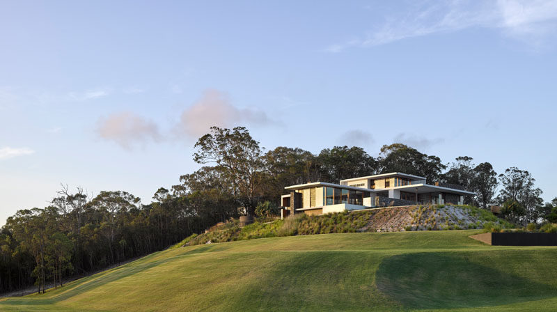 Australian architecture firm Base Architecture, have designed a modern family home in Queensland, that opens up to the surrounding outdoor spaces.
