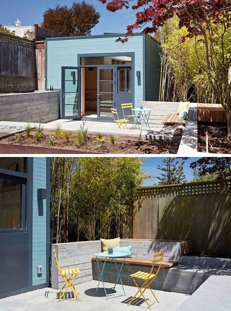 Solid bluestone pavers and board-formed concrete benches and planters were added to this small and modern courtyard, creating places to relax in the sun.