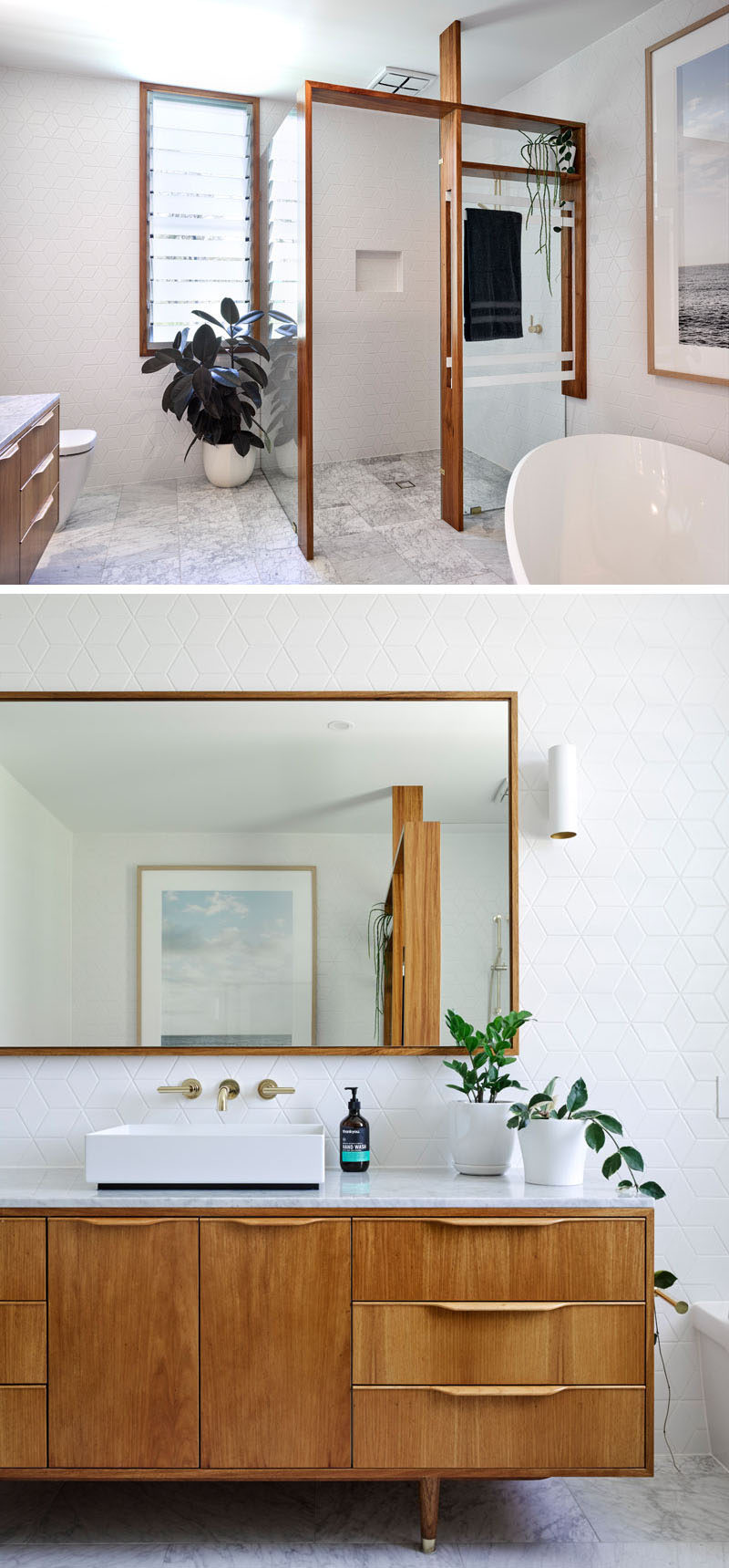 In this modern bathroom, wood frames have been used to provide support for the glass shower surround. Geometric white tiles on the walls add a slight texture, while the wood vanity ties in with the other wood elements for a contemporary bathroom design.