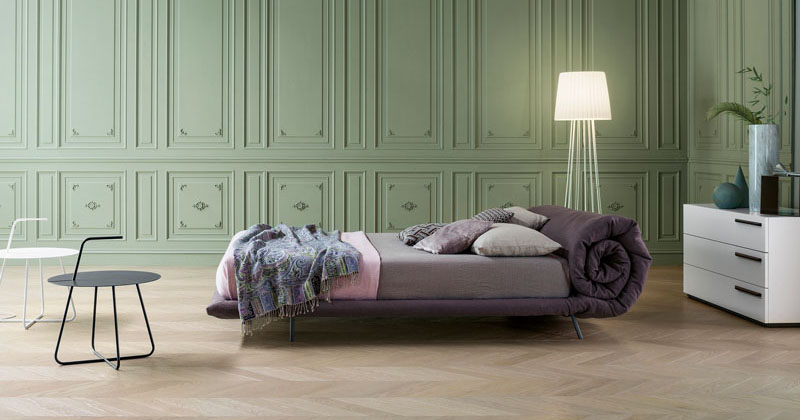 The base of this bed is designed to roll up and create a for Bed headrest design
