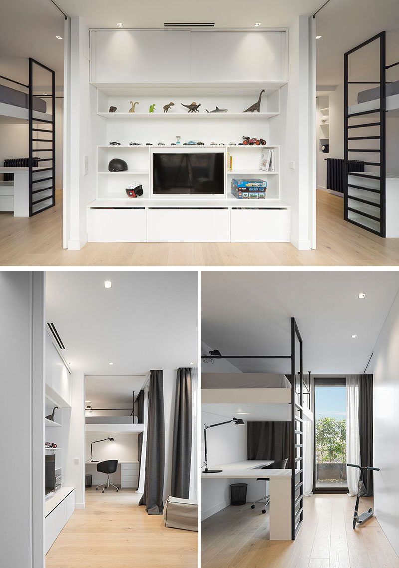 This bedroom has two sleeping areas that open up to a common tv area with shelving and storage. Each bed is lofted to provide space for a desk underneath and sliding doors can be closed for privacy.