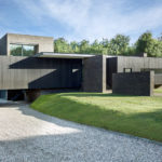 This New House Has A Large Cantilevered Section That Hangs Over The Driveway