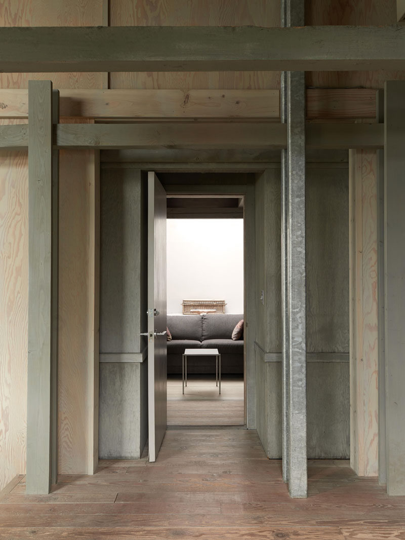 The interior of this modern cabin features plenty of wood.