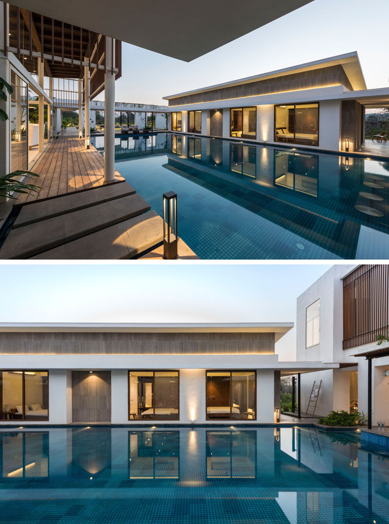 The living spaces and bedrooms of this modern house are located on either side of the swimming pool.