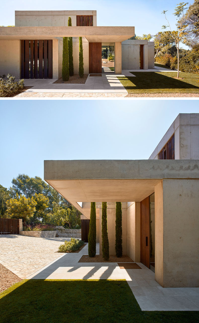 Natural state and stone, wood and visible concrete have been used throughout the design of this modern house.