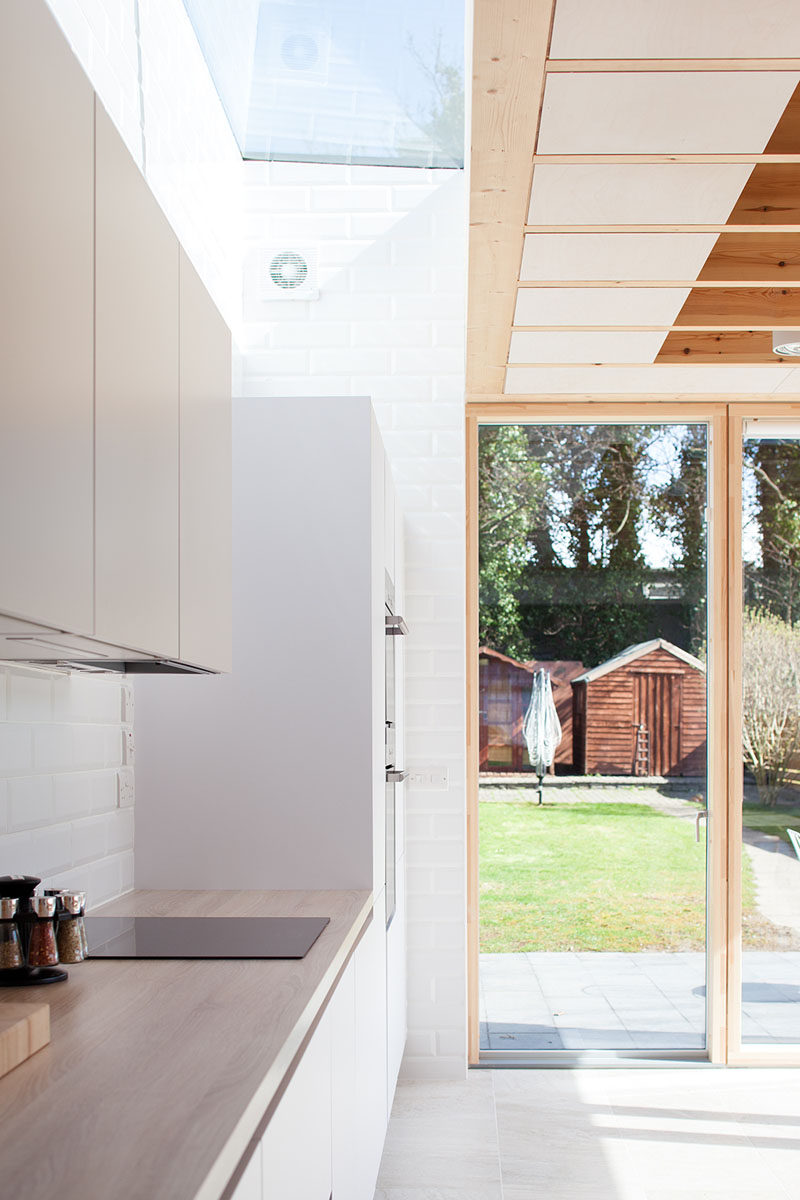 Large floor to ceiling windows and a glass door were used in this modern house extension to fulfill the clients requests to see their garden and to have a bright space.